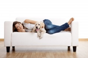 upholstery cleaning for Santa Rosa, Petaluma - woman and dog on couch